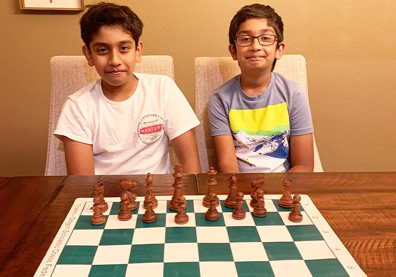 "The Chess Playing ""K"" Brothers. Super kids learning a super game"